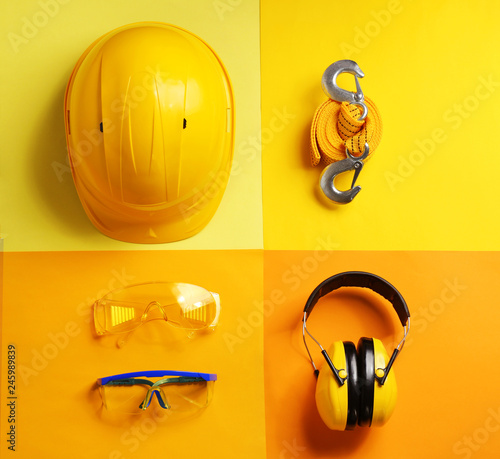 Photo  Flat lay composition with safety equipment on color background