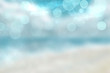 Leinwanddruck Bild - Abstract beach background. Abstract bright tropical sand beach with blue sky and white clouds and waves. Backdrop for summer holidays and travel advertising.