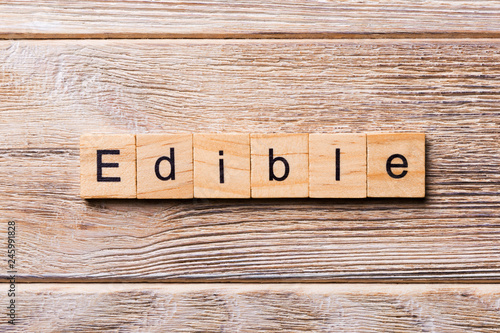 Fotografie, Obraz  EDIBLE word written on wood block