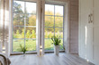 canvas print picture - Bright photo studio interior with big window, high ceiling, white wooden floor