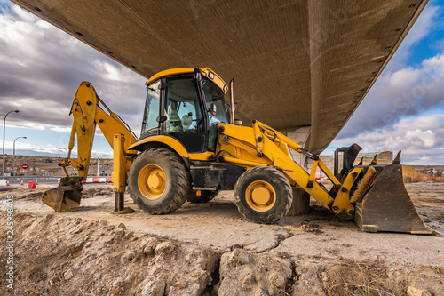 Backhoe in construction tasks of a road Canvas Print