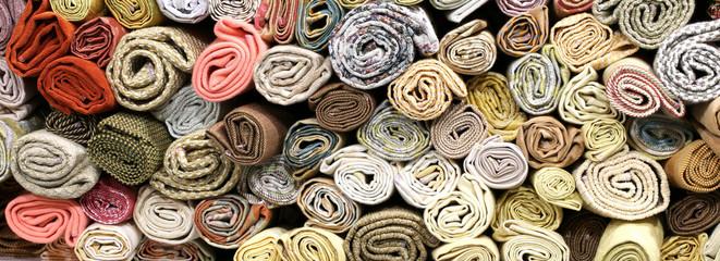 rolls of fabrics on the shelves