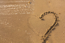 Half Of Heart On The Sand In ...