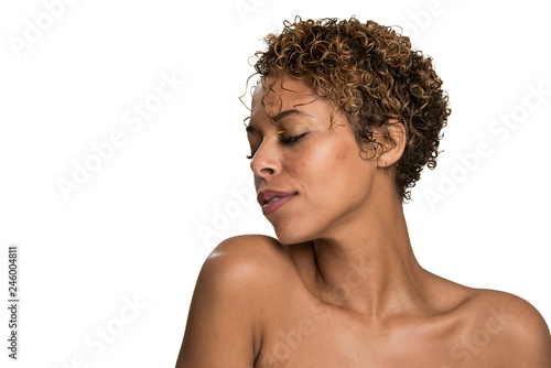 Fotografía  Head Shot of a Beautiful Woman Looking Down Isolated on White - Looking to Her R