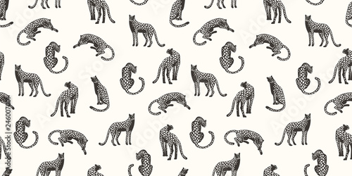 Fototapeta Seamless exotic pattern with abstract silhouettes of leopards.