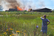Woman Looks In Summer On Fire