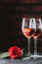 Two Wine Glasses Of Rose Wine On Brick Background, Bouquet Of Red Roses For Romantic Evening For Valentines Day Surprise, Marriage Proposal Passion And Love Celebration, Copy Space