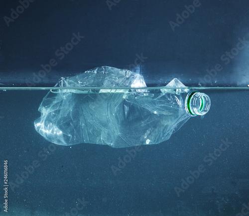 a Plastic water bottle pollution in ocean