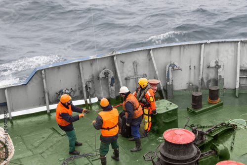 seamen carry out a rescue operation on the deck of a ship Canvas Print