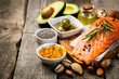 Leinwanddruck Bild Selection of healthy unsaturated fats, omega 3 - fish, avocado, olives, nuts and seeds