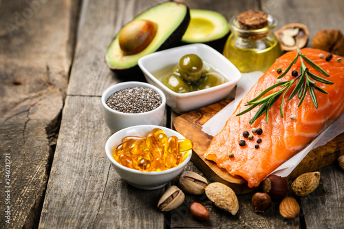Fototapeta Selection of healthy unsaturated fats, omega 3 - fish, avocado, olives, nuts and seeds obraz