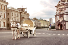 Emoty White Carriage With White Horse Waits For Tourists In Central Square, Kazan