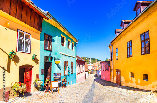 Vászonkép Sighisoara, Romania: Famous stone paved old streets with colorful houses in the