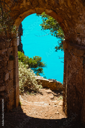 Ruins arch gate entrance of old fortress in Assos on Kefalonia island in Greece Canvas Print