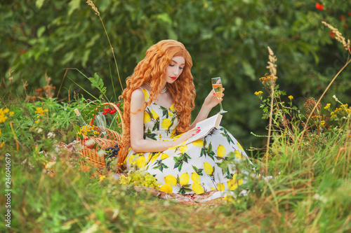 Redhead Girl With Curly Hair In Summer Dress With Lemons On