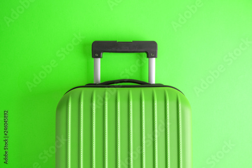 Luggage on green background minimalistic vacation concept. - 246045892