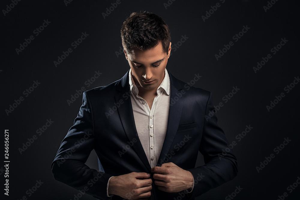 Fototapeta Handsome young elegant man in suit.