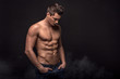 canvas print picture - Handsome shirtless man in studio.