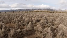 Slow Motion Forward Dolly Shot Of Desert Valley With Distant Mountains In Utah