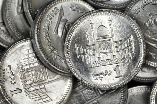 Fotografie, Obraz  A close up image of a pile of silver Pakistani one rupee silver coins