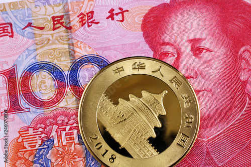 Fotografie, Obraz  A close up image of a Chinese 100 yuan bank note with a Chinese one ounce golden