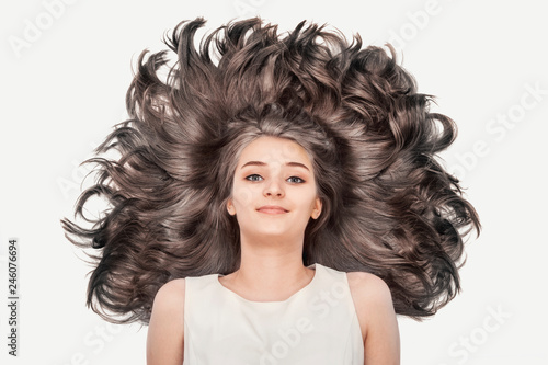 Photo Nice young girl with luxurious blond hair on a white background