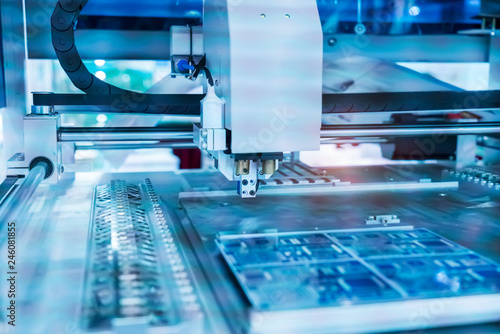 Obraz PCB Processing on CNC machine,Production of electronic components at high-tech factory - fototapety do salonu