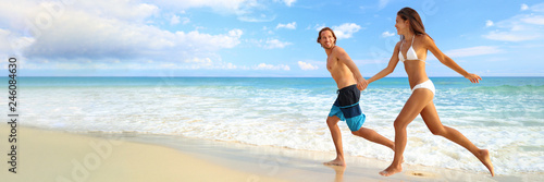 Beach vacation couple happy running of fun on landscape background banner. Young people tourists on tropical Caribbean holiday summer travel.