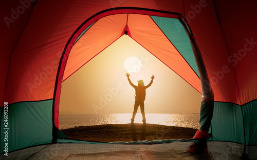 Foto op Plexiglas Rood paars Tent view on window with man standing and open hand on sunset or sunrise background