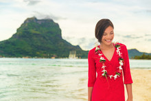 Bora Bora Luxury Vacation Beautiful Asian Tourist Woman On Tahiti French Polynesia Cruise Ship Travel Adventure. Girl Smiling Wearing Lei Flower Necklace On Sunset Beach Walk.