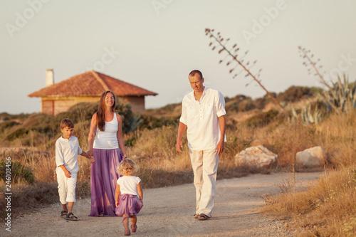 Fotografia, Obraz  portrait of Happy nice family near home, dawn