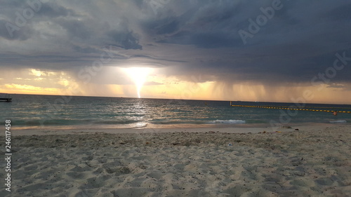 Foto op Canvas Zee zonsondergang Lightning on the Beach