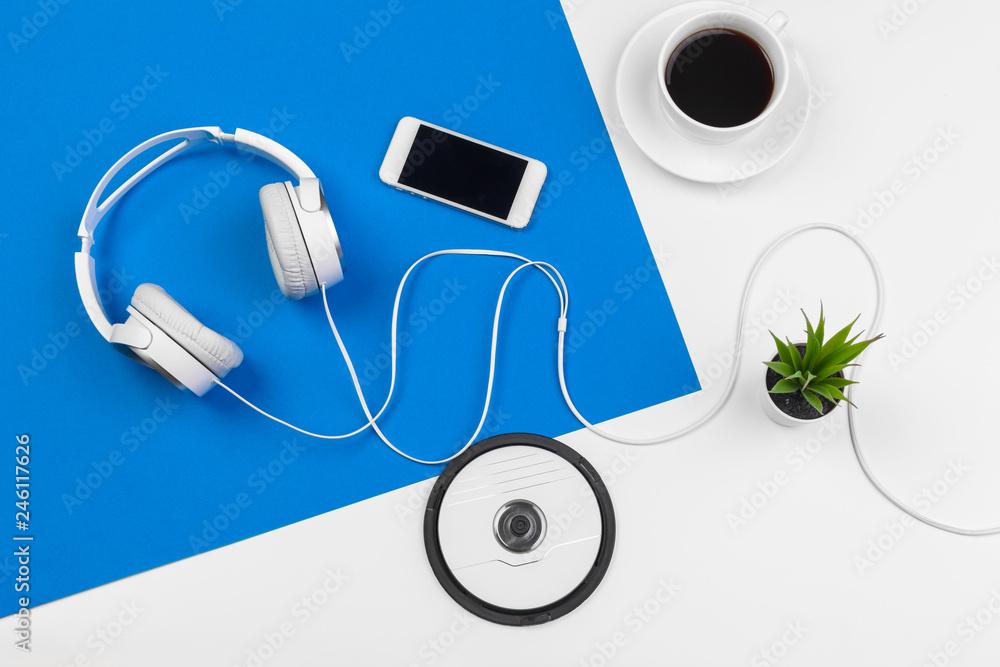 Fototapeta Stylish headphones on blue and white color background, top view. - obraz na płótnie
