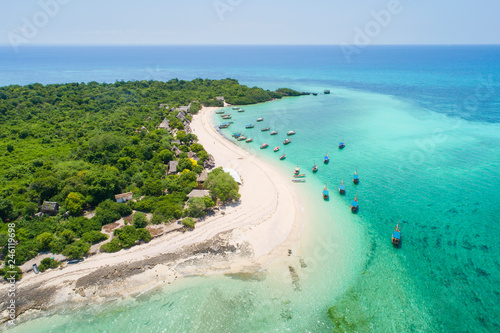 Zanzibar curved coast with boats in lagoon on Zanzibar island