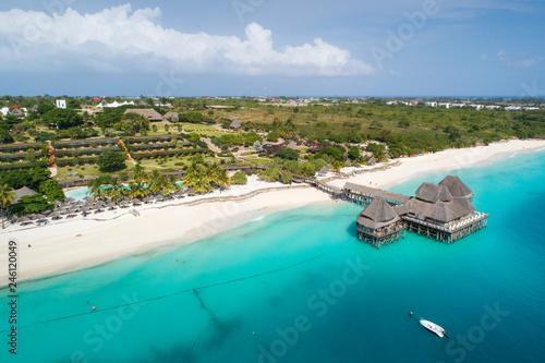 Foto auf AluDibond Sansibar view to clouds and beach with wooden restaurant on Zanzibar island