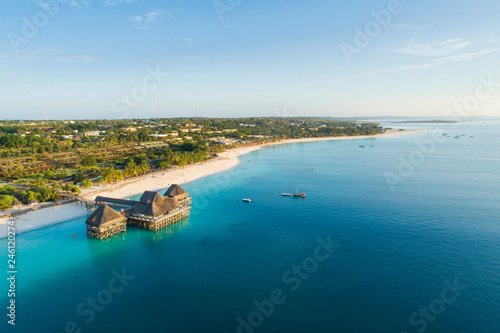 Spoed Foto op Canvas Zanzibar aerial view to coast line with wooden pier on Zanzibar