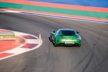 Beautiful Green Race Car Rides Along Race Track