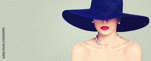 Carta da parati Fashion portrait of stylish woman with red lips makeup, elegant hat and pearls