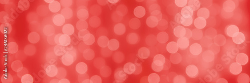 Foto  abstact holiday coral background with bokeh light balls