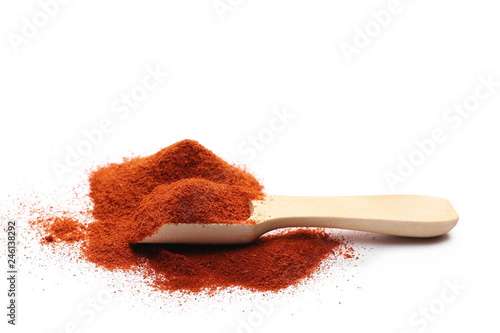 Pile of red paprika powder with wooden spoon isolated on white background Fototapeta