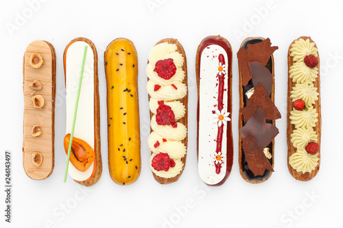 Carta da parati Group of french dessert Eclair on white background, top view