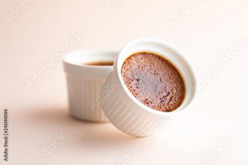 Homemade Caramel Creme Brulee in white ramekin macro Fototapet