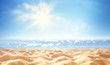 Summer background, nature of tropical golden beach with rays of sun light. Golden sand beach, sea water against blue sky with white clouds. Copy space, summer vacation concept.