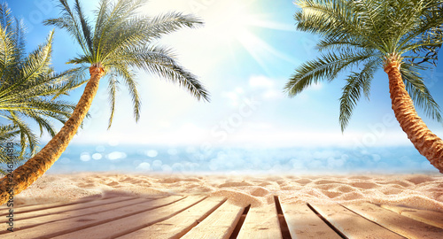 Stickers pour porte Palmier Summer panoramic landscape, nature of tropical beach with wooden platform, sunlight. Golden sand beach, palm trees, sea water against blue sky with white clouds. Copy space, summer vacation concept.