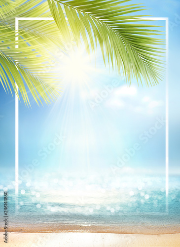 Summer background with frame, nature of tropical golden beach with rays of sun light and leaf palm. Golden sand beach close-up, sea water,  blue sky, white clouds. Copy space, summer vacation concept. Wall mural