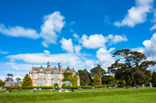 Tourists Relaxing Around The Gardens Of Muckross House In The Ring Of Kerry
