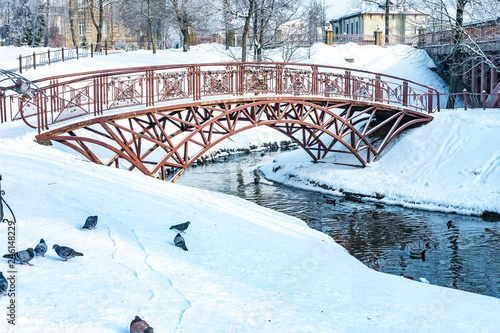 Foto op Canvas Drawn Street cafe panorama of a snowy city park with a river and a bridge