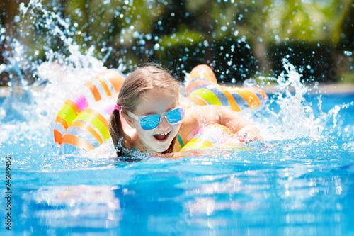 Child in swimming pool. Kids swim. Water play. Wallpaper Mural