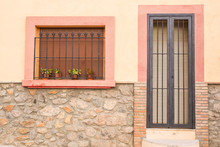 Design, Architecture And Exterior Concept - Small Window And Door With Lattice On The White Facade