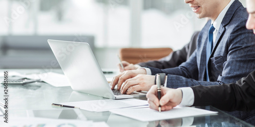 Fototapeta business team conducting analysis of marketing reports at the workplace obraz na płótnie
